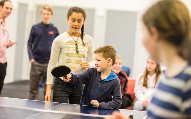 Children playing table tennis