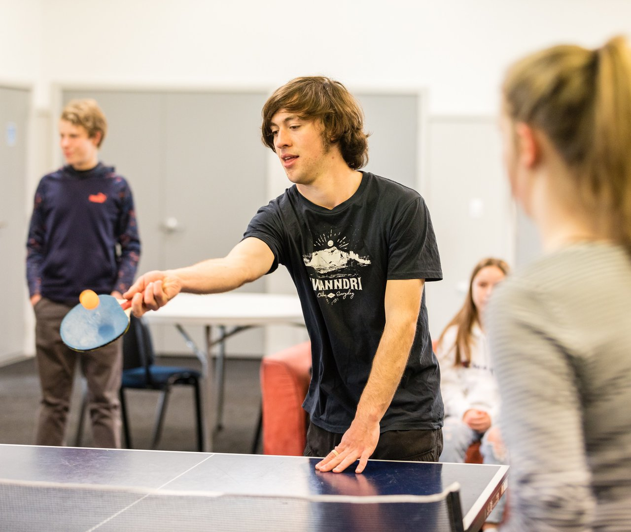 Young people playing table tennis